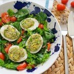 Stuffed Eggs on Spinach